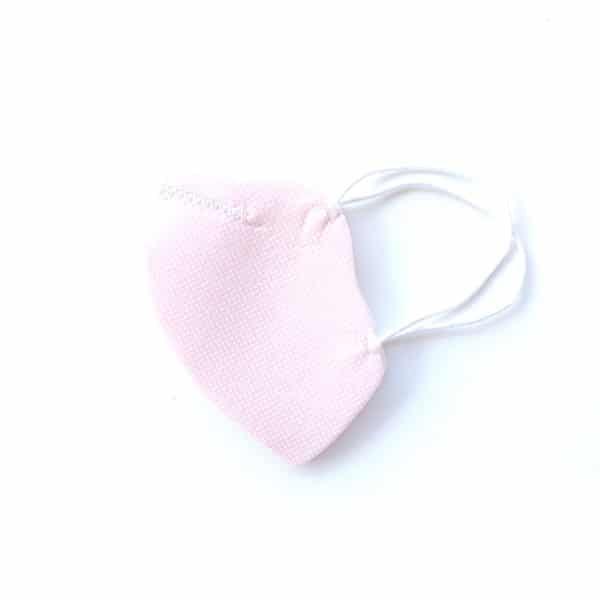 mascarilla rosa con puntitos blancos